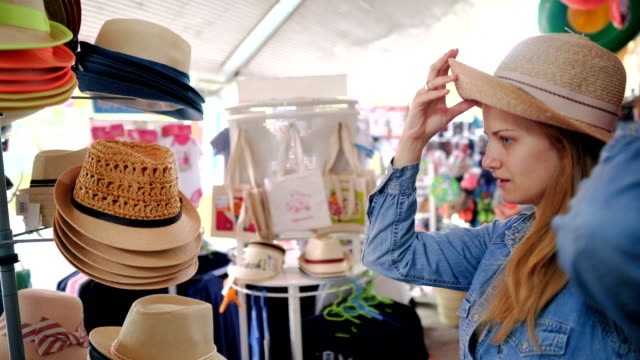 tourist woman shopping on summer vacation - thessalonika stock videos & royalty-free footage
