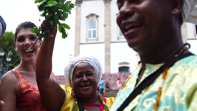 tourist woman taking a selfie with local brazilian religious people - bahia state stock videos and b-roll footage
