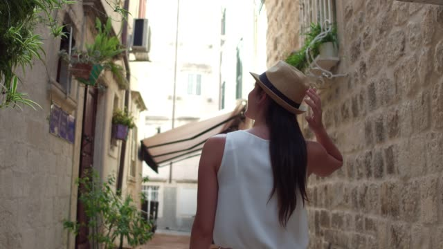 tourist woman walking and discovering the dubrovnik old town, croatia - old town stock videos & royalty-free footage