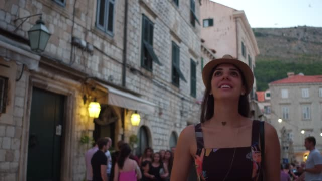 tourist woman walking and discovering the dubrovnik old town, croatia - tourist stock videos & royalty-free footage