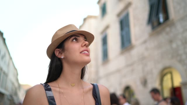 tourist woman walking and discovering the dubrovnik old town, croatia - brown hair stock videos & royalty-free footage