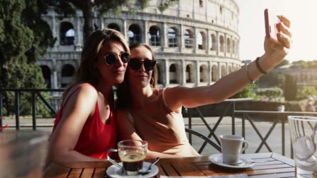 tourist women at bar under the coliseum of rome - two people stock videos & royalty-free footage