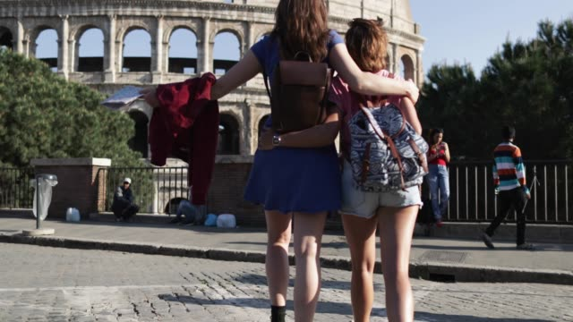 tourist women in rome: by the coliseum - guide stock videos & royalty-free footage