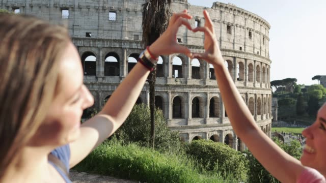 tourist women in rome: by the coliseum - italy stock videos and b-roll footage