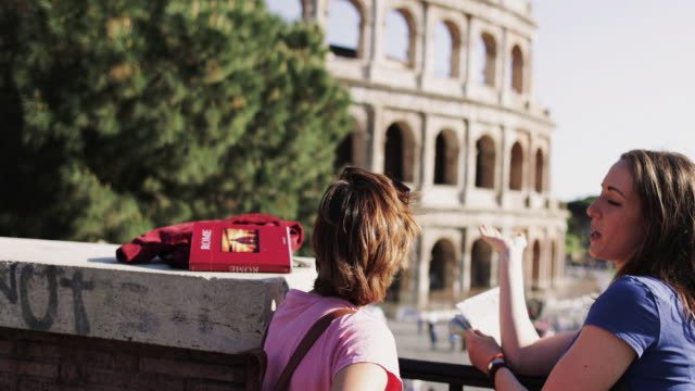 tourist women in rome during summer holidays: by the coliseum - guide stock videos & royalty-free footage