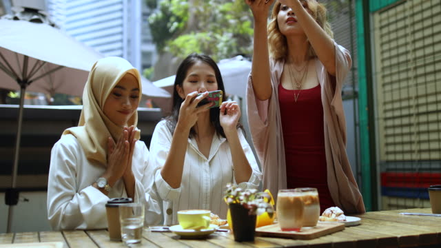 tourist young muslim women taking pictures of food in kuala lumpur - islam stock videos & royalty-free footage
