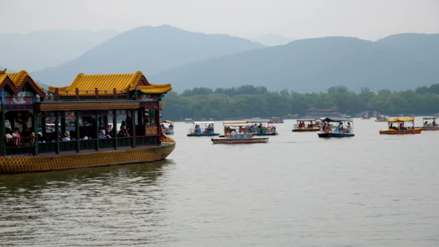 Touristic boat navigating into the lake in the Summer City in Beijing