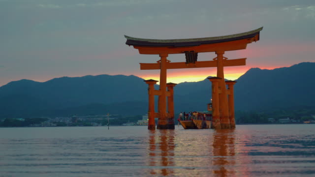 touristic boat under a torii gate in japan - shrine stock videos & royalty-free footage