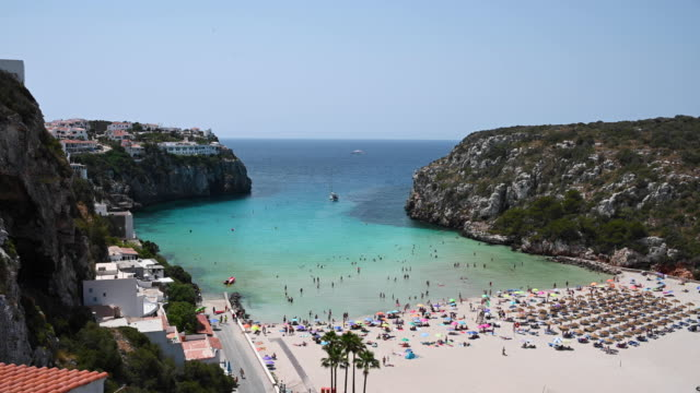 touristic holiday beach in cala en porter in menorca in spain by the sea - minorca stock videos & royalty-free footage