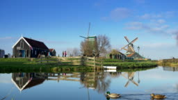 Touristic wooden houses and windmills at the Zaanse Schans. Holland