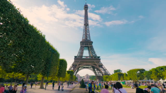 Tourists activity in Champs de Mars by the Eiffel Tower.