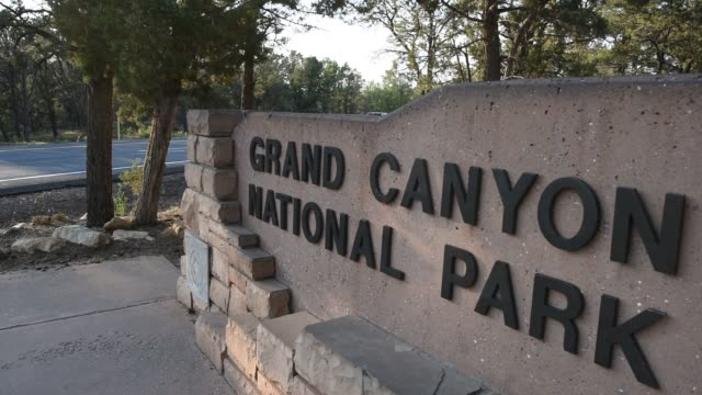 Tourists and hikers visit the Grand Canyon in Arizona on July 15 2015 Shots Close up shots of signage at the entrance to Grand Canyon National Park