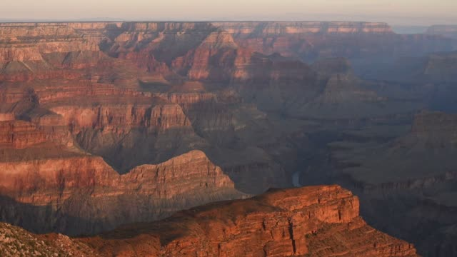tourists and hikers visit the grand canyon in arizona on july 15, 2015. shots: beautiful wide landscape shots of the sun setting over the grand... - grand canyon national park stock videos & royalty-free footage