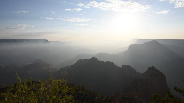 Tourists and hikers visit the Grand Canyon in Arizona on July 15 2015 Shots Wide shots of the Grand Canyon landscape shrouded in mist or fog