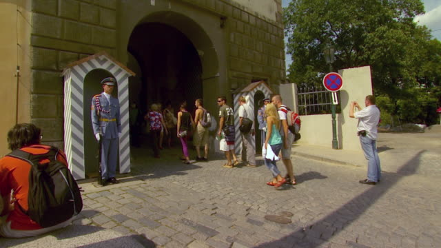 ws tourists and honor guards at entrance to hradcany castle / prague, czech republic - hradcany castle stock videos and b-roll footage