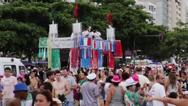 ws tourists and locals celebrate in a carnival street celebration in copacabana on march 01 2014 in rio de janeiro brazil - copacabana stock videos & royalty-free footage