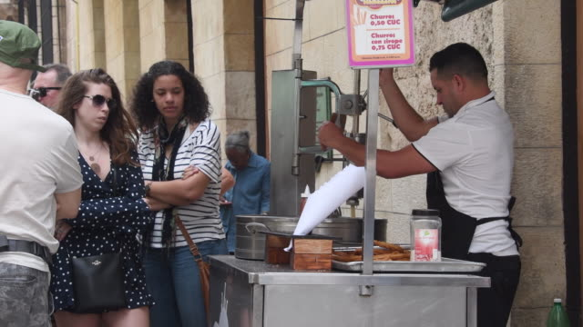 tourists and locals line up for buying fritters in a corner of the colonial city / the snack used to cost 1 cuban peso / after the reforms where... - churro stock videos & royalty-free footage
