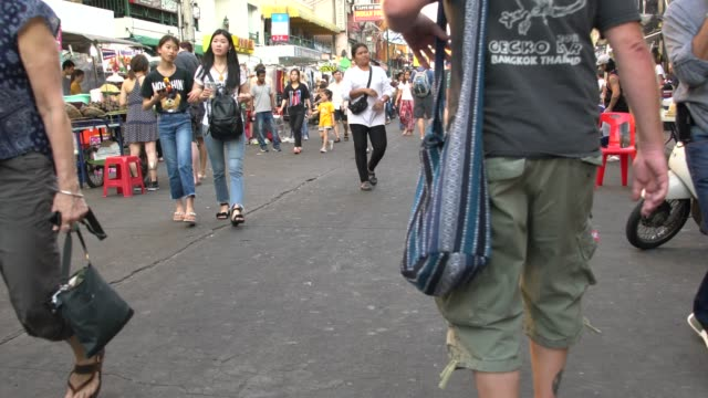 Tourists And Locals Visiting The Khao San Road In Bangkok, Thailand