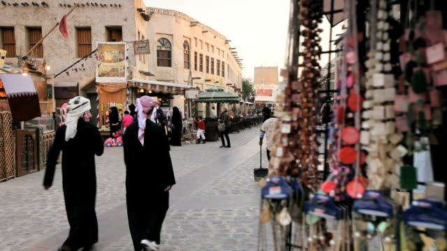 tourists and locals walk along the shops of the restored souq waqif in doha, qatar. - doha bildbanksvideor och videomaterial från bakom kulisserna