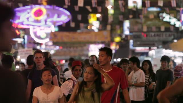 ls tourists and locals walk down koh san road / bangkok, thailand - bangkok stock videos & royalty-free footage