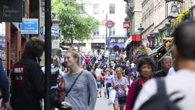 tourists and london locals fill the busy streets of central london, england on august 14, 2020. london's air pollution regularly exceeds eu air... - engine stock videos & royalty-free footage