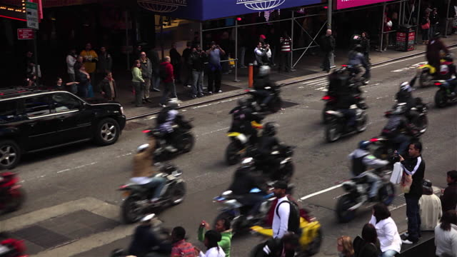 tourists and motorcycle in ny times square - biker gang stock videos & royalty-free footage