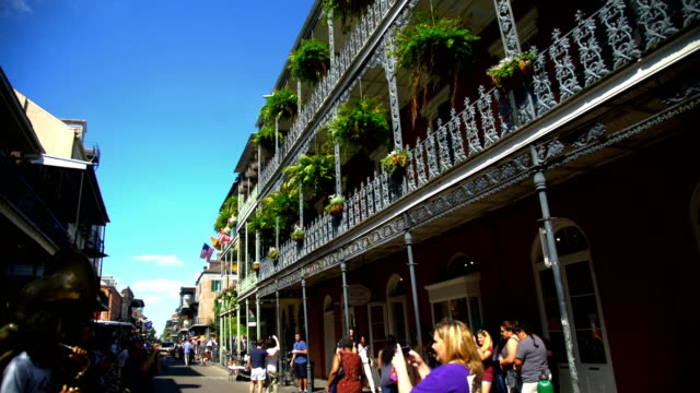 tourists and musicians in french quarter new orleans - new orleans stock videos & royalty-free footage