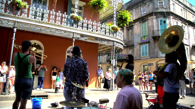 tourists and musicians in french quarter new orleans - musician stock videos & royalty-free footage