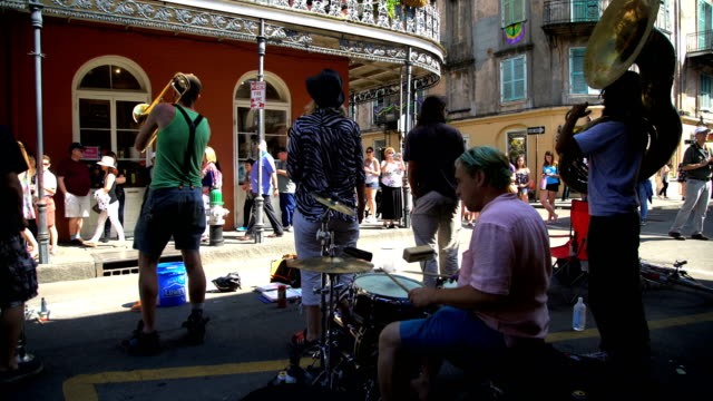 tourists and musicians in french quarter new orleans - blues stock videos & royalty-free footage
