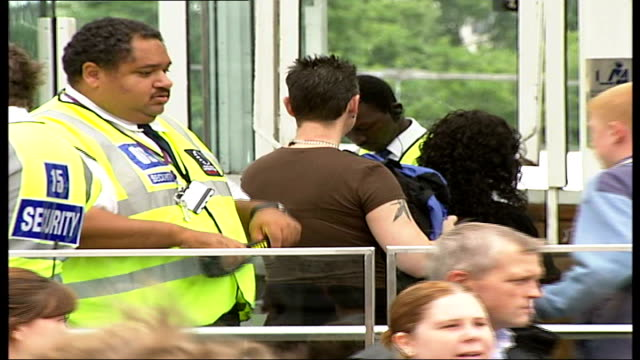tourists and police in covent garden and london eye south bank low angle view of london eye / security guards searching tourists' bags as they queue... - searching stock videos and b-roll footage
