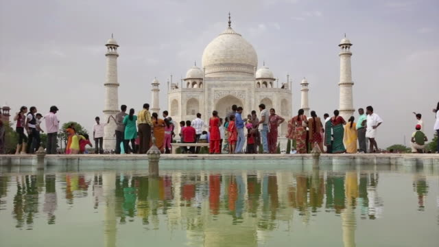 ls tourists and reflecting pool in front of taj mahal / agra, uttar pradesh, india - taj mahal stock videos and b-roll footage