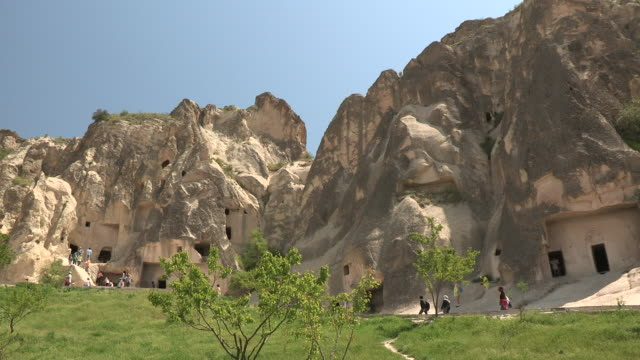 tourists and settlements, cappadocia, turkey - cliff dwelling stock videos & royalty-free footage
