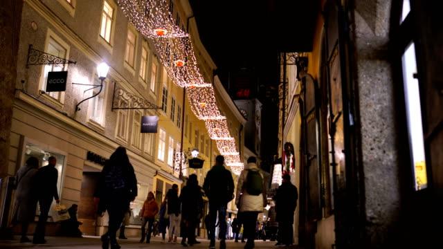 tourists and shoppers getreidegasse salzburg austria - traditionally austrian stock videos & royalty-free footage