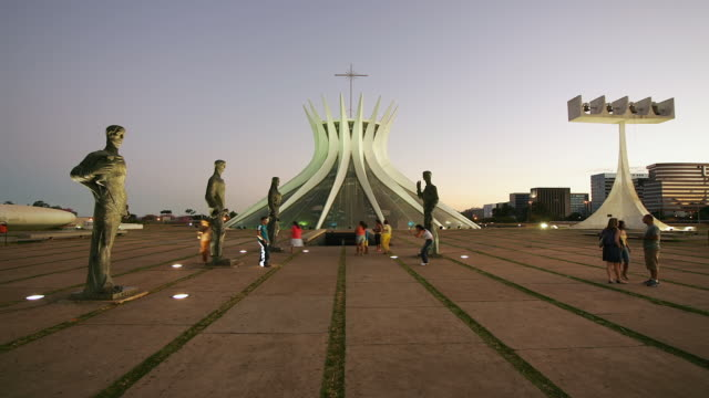 t/l, ws, tourists and statues in front of cathedral of brasilia, day to night, brasilia, brazil - brasilia stock videos and b-roll footage