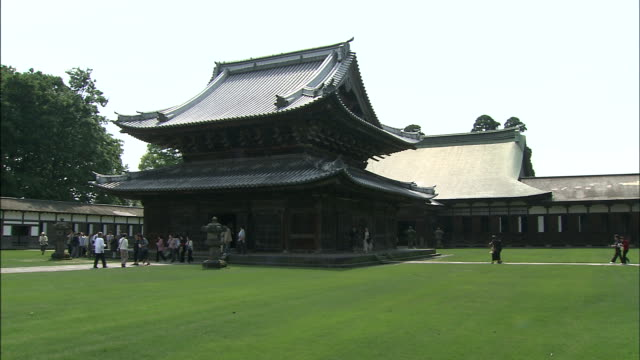 tourists approach the zuiryu-ji temple. - toyama prefecture stock videos and b-roll footage