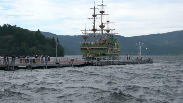 Tourists Approaching A Tourist Pirate Ship On Lake Ashi In Hakone, Japan