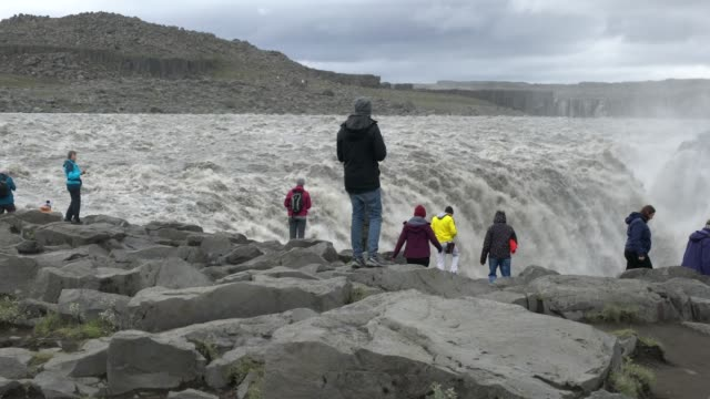 tourists approaching dettifoss waterfall in iceland - pavel gospodinov stock videos & royalty-free footage