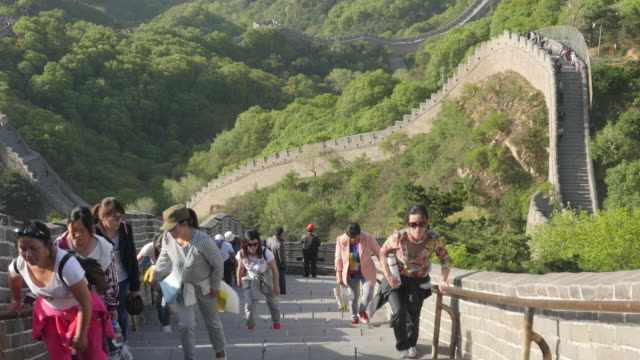 tourists are climbing the badaling great wall in beijing, china - badaling great wall stock videos & royalty-free footage