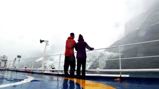 tourists are passing the cruise ship in the lemaire channel, antarctica - cruise antarctica stock videos & royalty-free footage