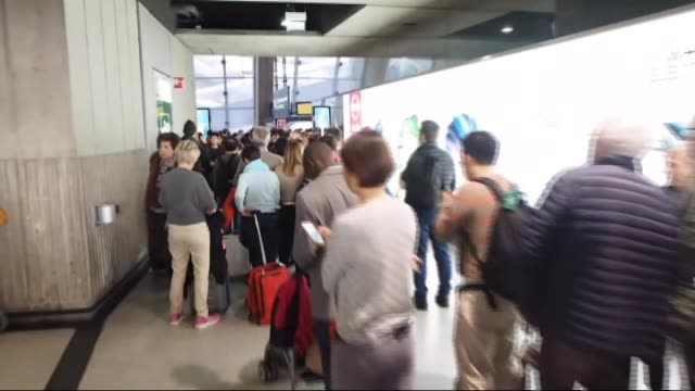 Tourists are seen as they wait in queues after they swarmed Charles De Gaulle airport in Paris France on November 14 2015 following the attacks that...