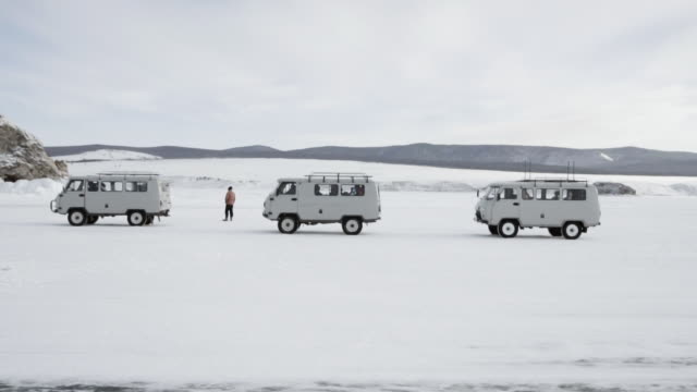 Tourists are shooting selfies on the hummocks of Lake Baikal