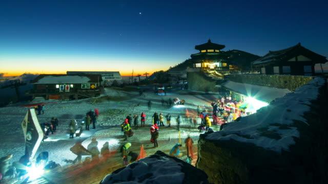 tourists around gazebo shaped observatory on snowy mt deogyusan night view - gazebo stock videos & royalty-free footage