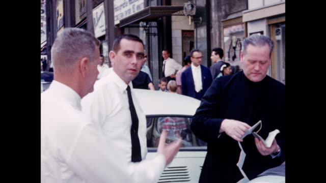 1960 tourists ask directions in rome - clergy stock videos & royalty-free footage
