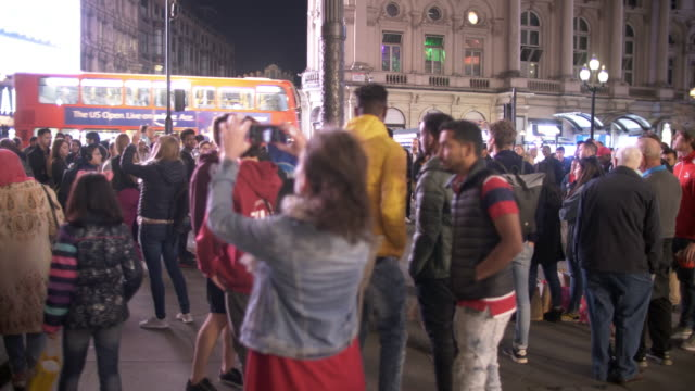 tourists assembling in london piccadilly circus - photographing stock videos & royalty-free footage
