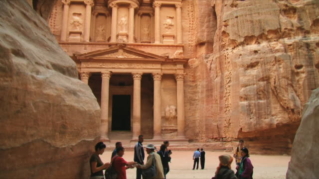 ms tu tourists at al khazneh (the treasury) / petra, jordan - treasury stock videos and b-roll footage