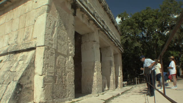 ws tourists at annex of temple of the jaguar at pre-columbian archaeological site built by maya civilization / chichen itza, yucatan, mexico - pre columbian stock videos & royalty-free footage