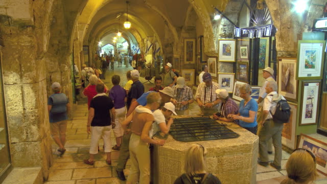 ws pan tourists at cardo, jewish quarter in old city of jerusalem / jerusalem, israel - curiosity stock videos and b-roll footage