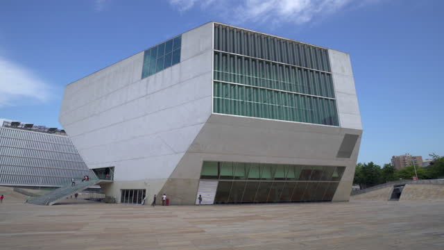 tourists at casa da musica on vacation during sunny day against cloudy sky - porto, portugal - walkable city stock videos & royalty-free footage