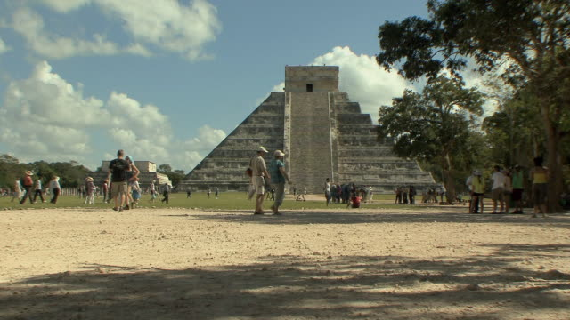 ws tourists at el castillo, mesoamerican step-pyramid served as temple to god kukulkan at pre-columbian archaeological site built by maya civilization / chichen itza, yucatan, mexico - pre columbian stock videos and b-roll footage