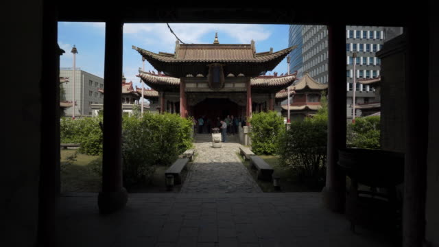 tourists at entrance of choijin lama temple in city during sunny day  - ulaanbaatar, mongolia - monastery stock videos & royalty-free footage